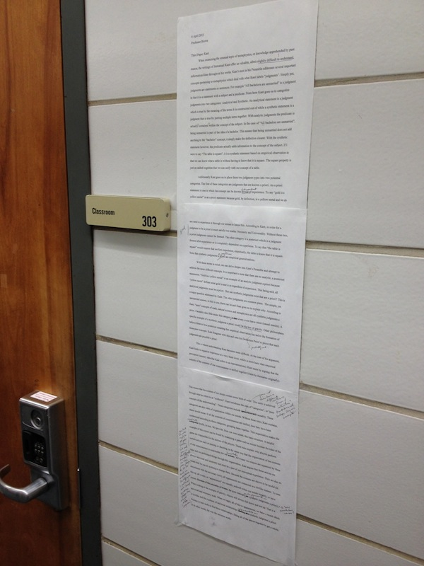 A low-tech approach to making student writing more public: anonymous student paper, with philosophy instructor's comments, posted in the hallway.